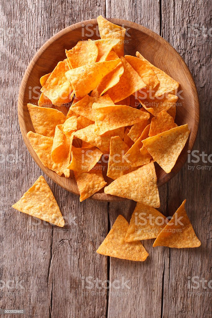 Nachos corn chips in the bowl on table. vertical view stock photo