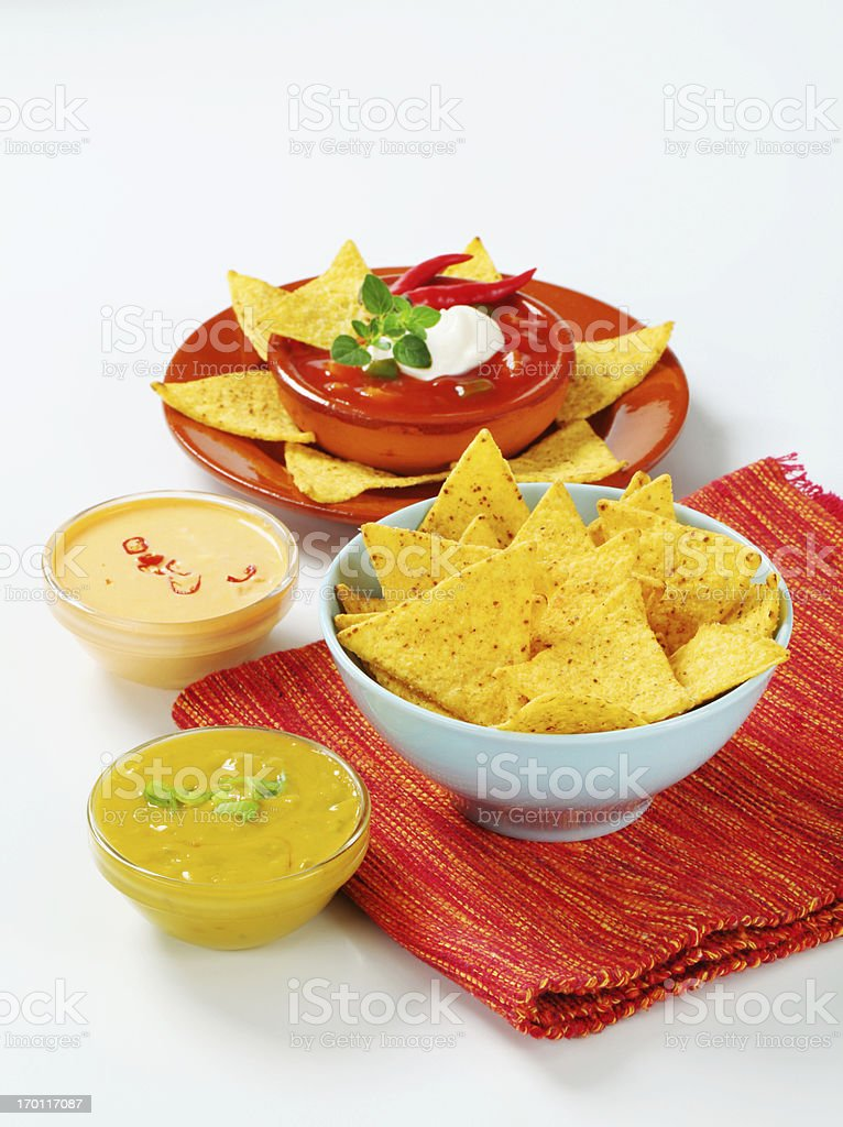 Nachos in bowl and mix of dips royalty-free stock photo