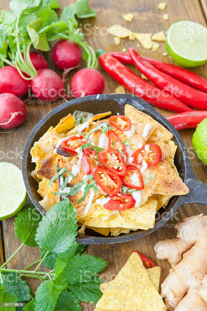 Nachos with cheese and chili peppers stock photo