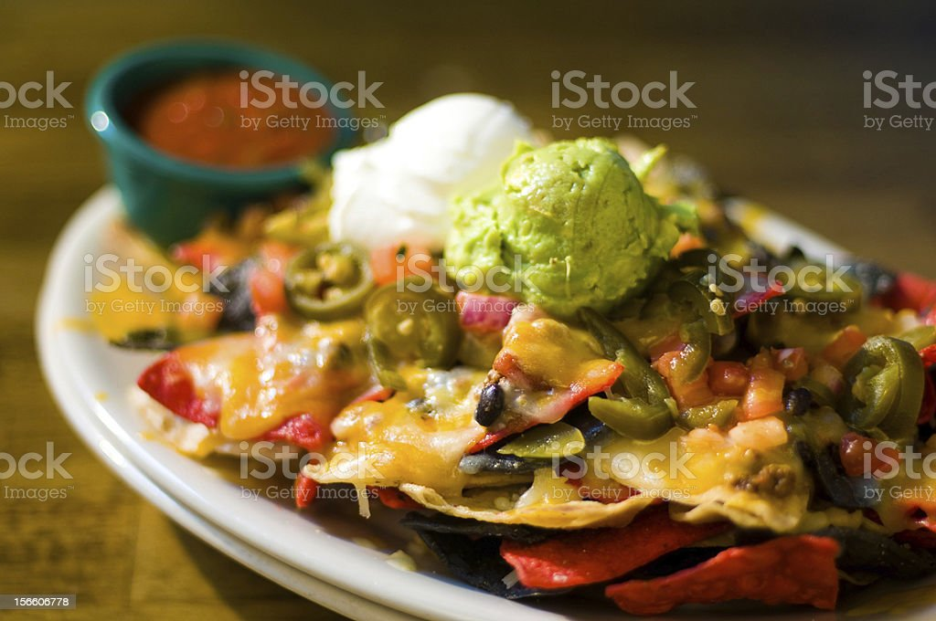 Nachos with cheese and guacamole stock photo