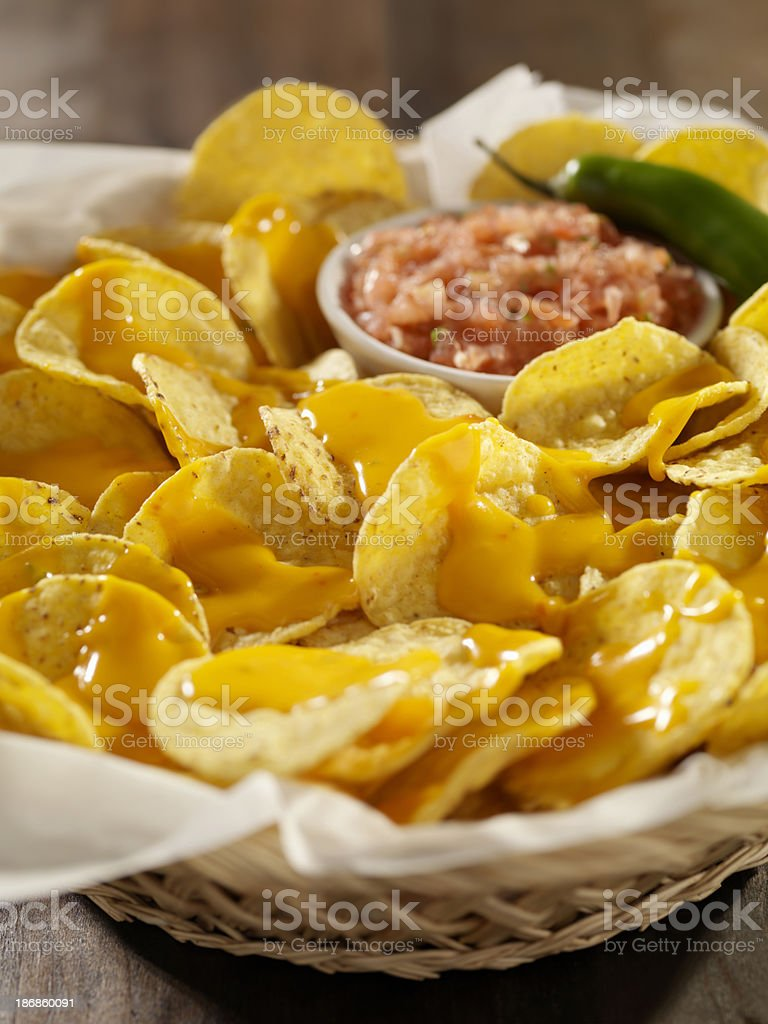 Nachos with Cheese Sauce and Salsa stock photo