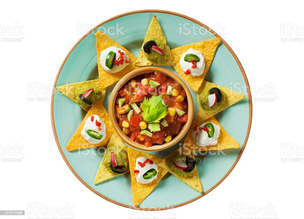 Nachos with dips and a bowl of salsa royalty-free stock photo