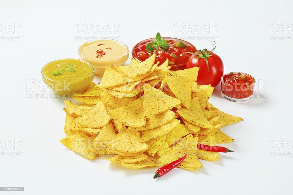 Nachos with mix dips royalty-free stock photo