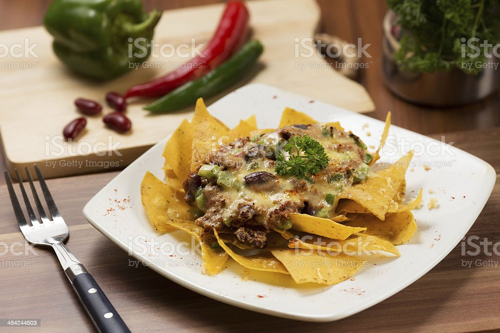Nachos with Red Pea Sauce and Parsley royalty-free stock photo