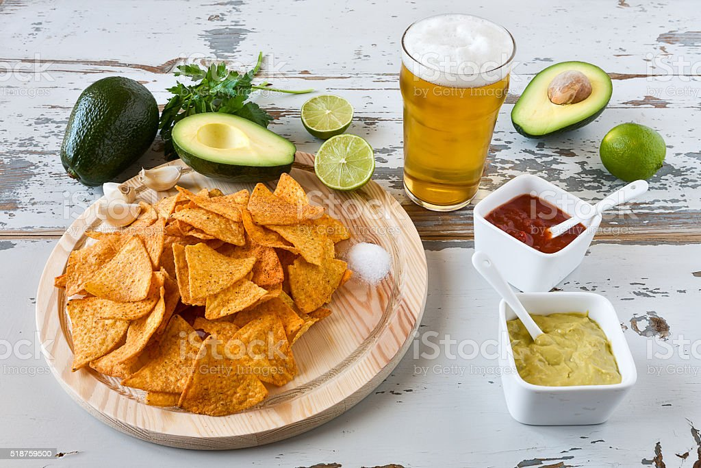 Nachos with sauces beer and avocado stock photo