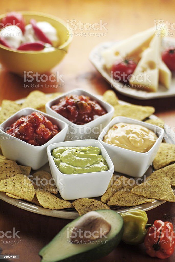 Nachos with Various Dips royalty-free stock photo