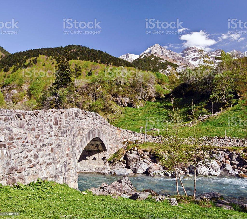 Nadau bridge through Gave de Gavarnie river stock photo