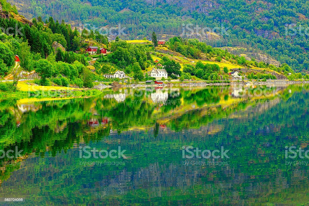 Naeroyfjord idyllic fjord landscape reflection, Norwegian fishing village, Norway, Scandinavia stock photo