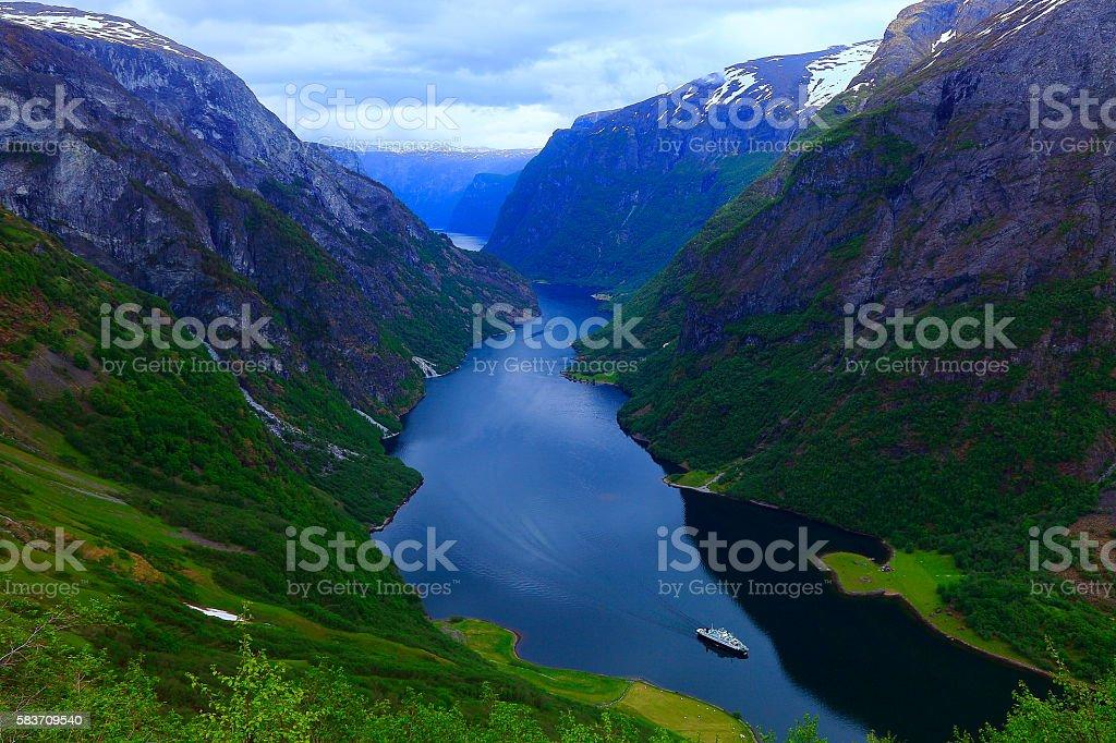 Naeroyfjord idyllic fjord landscape, ship Cruise, dramatic evening, Norway, scandinavia stock photo