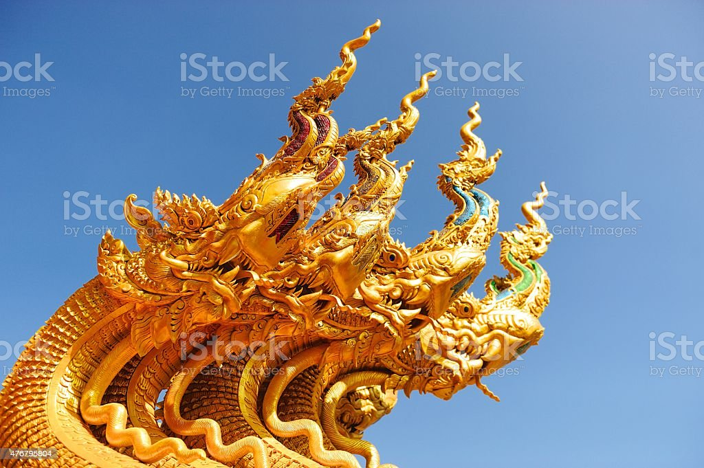 Naga snake guarding Thai temple entrance royalty-free stock photo