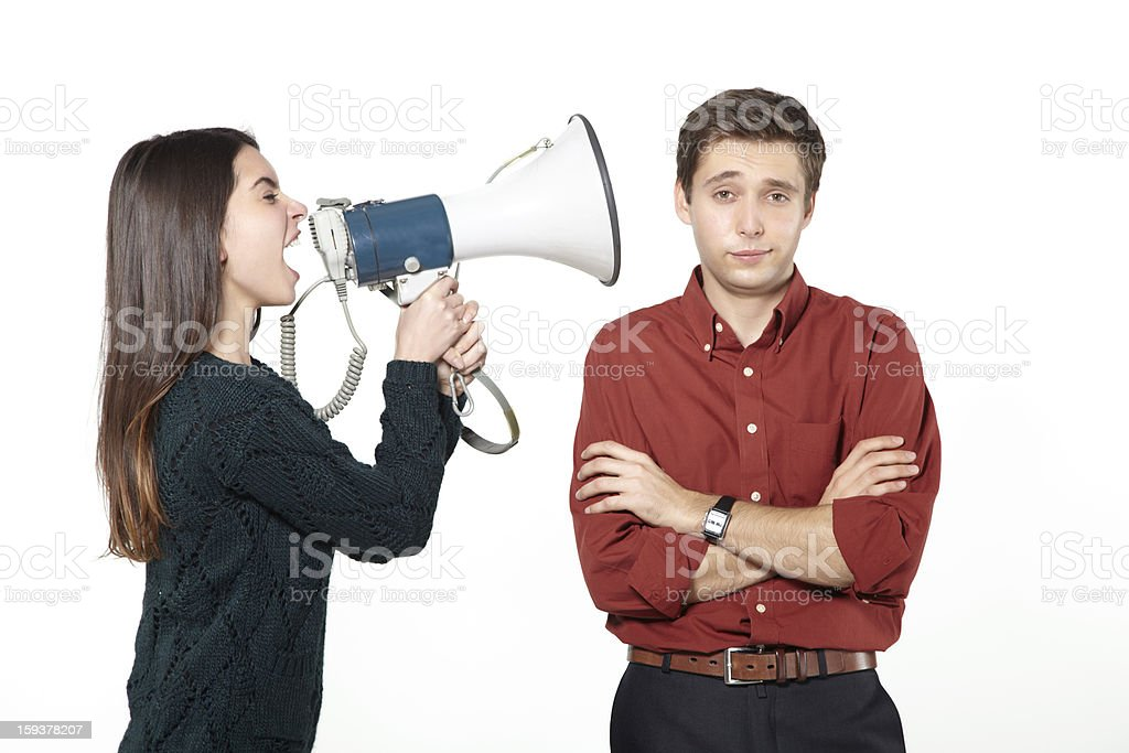 Nagging woman with megaphone royalty-free stock photo