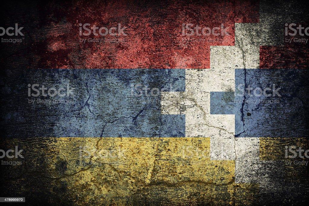 Nagorno-Karabakh flag pattern on dirty old concrete wall texture stock photo