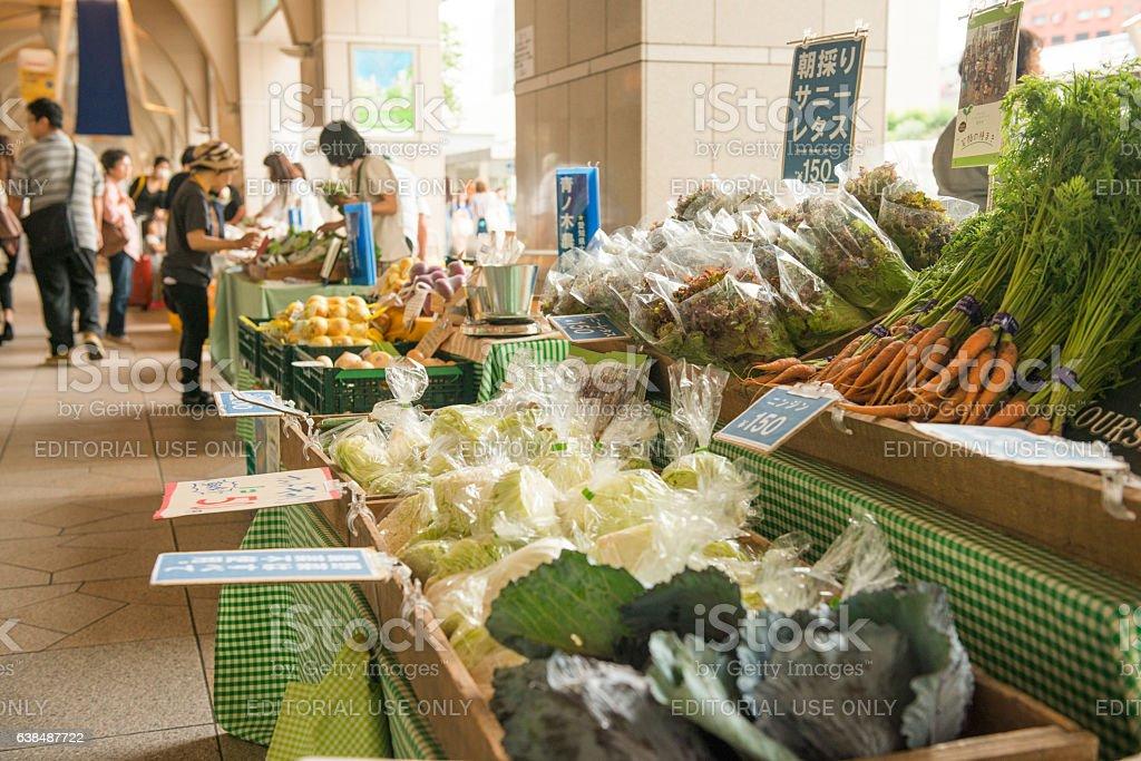 Nagoya Farmers Market Vendor Business Selling Produce on Sidewalk Japan stock photo