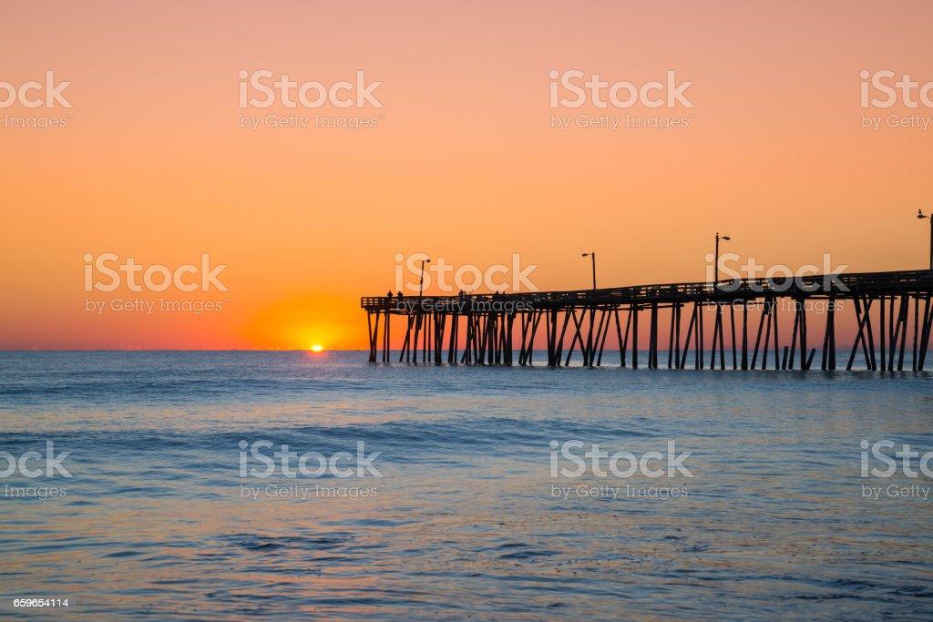 Nags Head Pier at sunrise stock photo