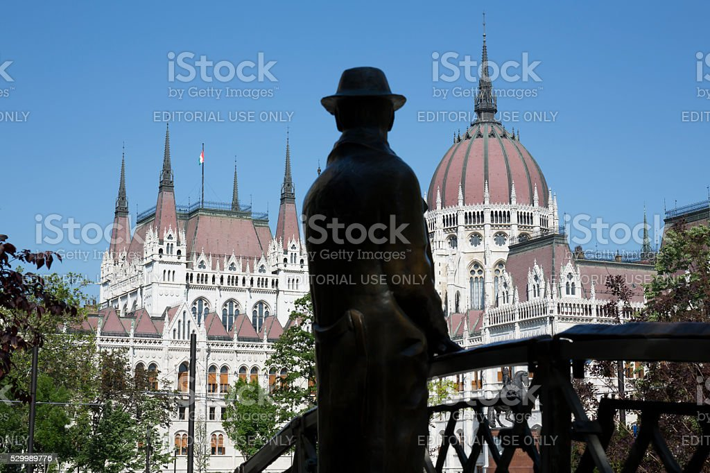 Nagy Imre statue silhouette and the Hungarian Parliament in Budapest stock photo