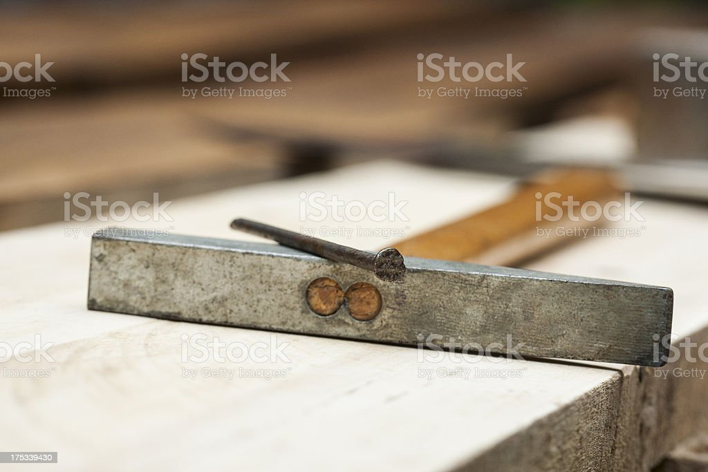 Nail and hammer closeup shot royalty-free stock photo