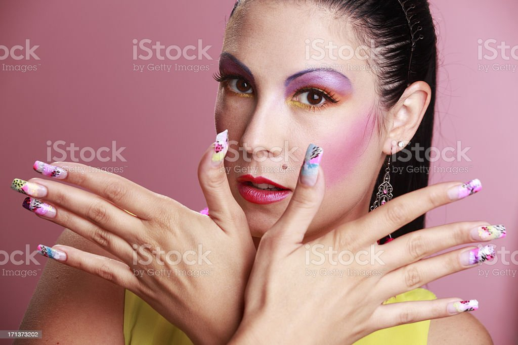 Woman with art make-up and art fingernail coloring.