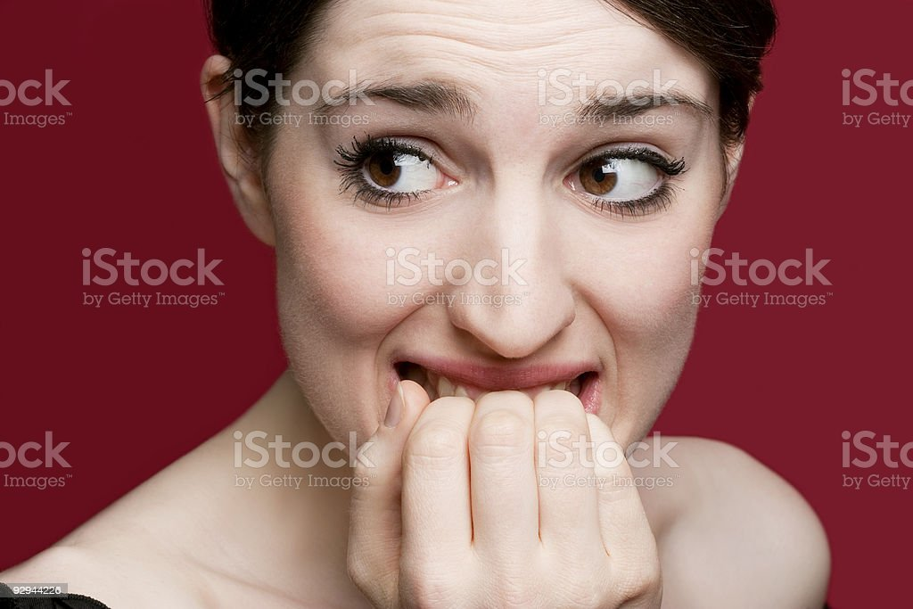 Nail biting and scared stock photo