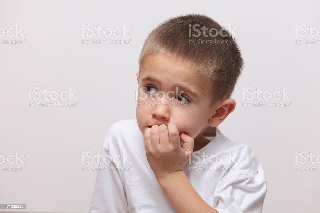 nail biting boy royalty-free stock photo
