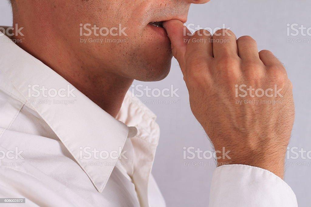 Nail biting , nervous business man, stress concept stock photo