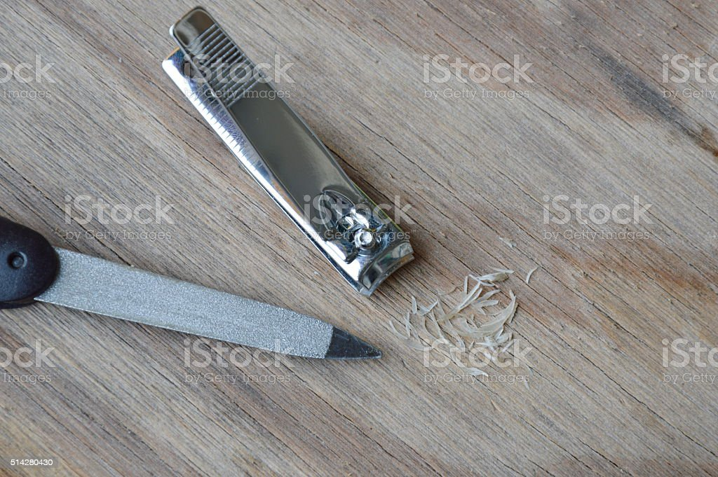 nail clipper and emery file on plank stock photo