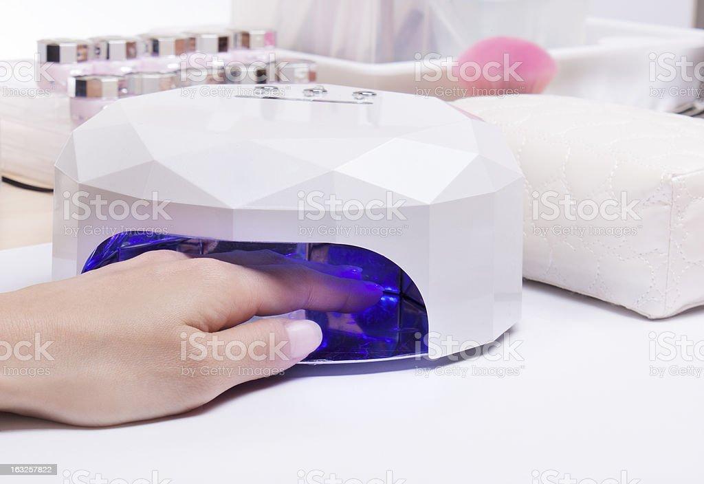 Nail gel UV light lamp dryer stock photo