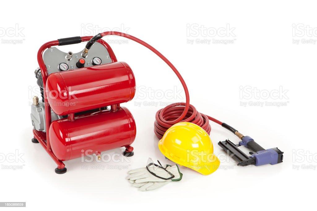Nail Gun, Air Compressor, and Safety Equipment stock photo