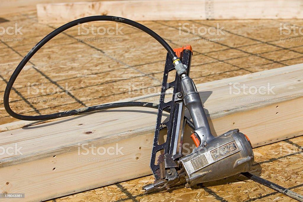Nail Gun at Construction Site stock photo