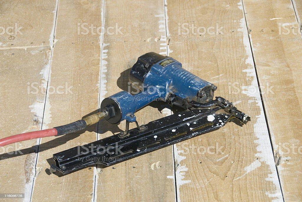 Nail Gun – Framing Nailer  - Lying on Roof Boards stock photo