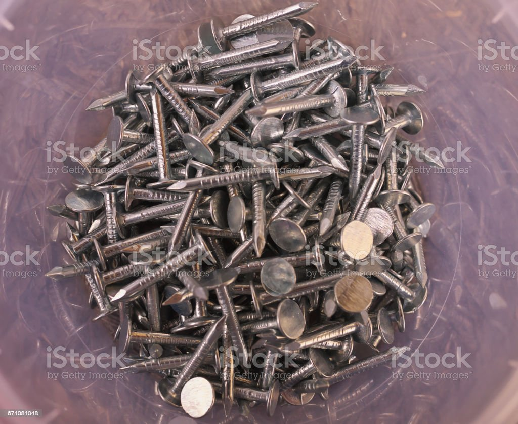 nail heads and nails for roof, hobnails stock photo