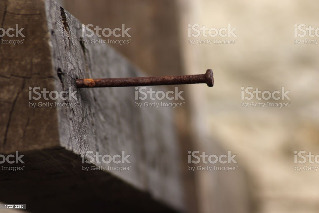 Nail in a wooden cross stock photo