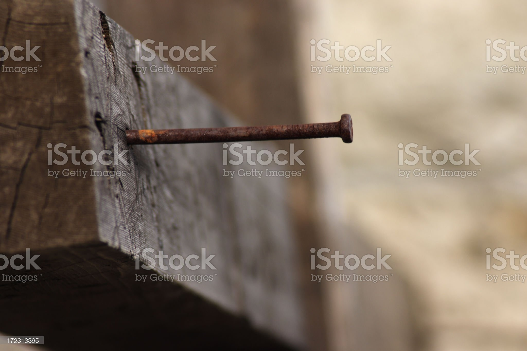 Nail in a wooden cross royalty-free stock photo