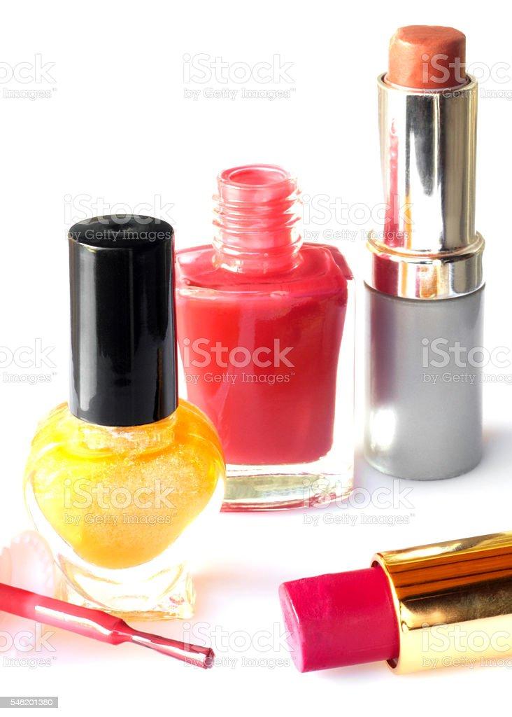 Nail polish and lipstick isolated on white background stock photo