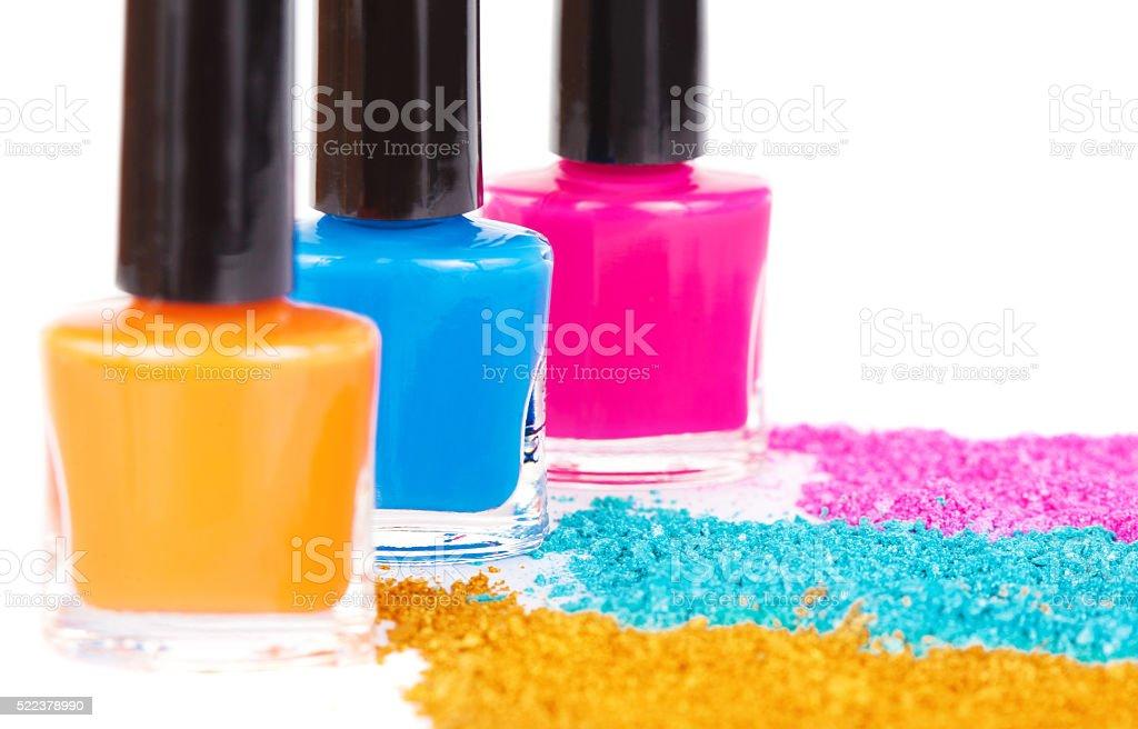 Nail polish and powdery eye shadow stock photo