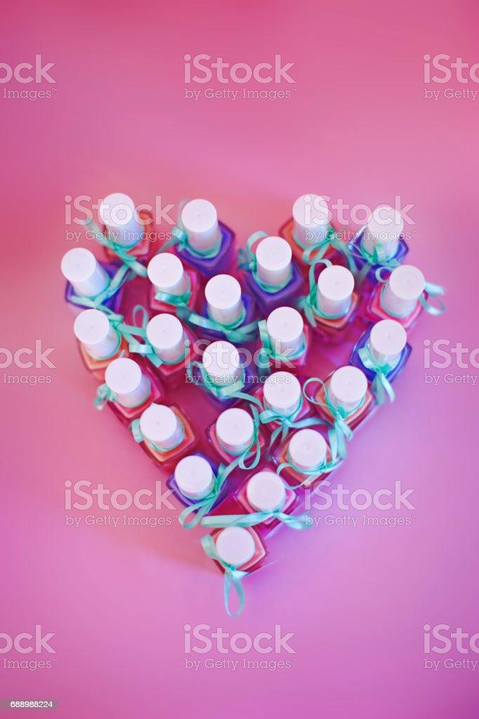 Nail polish assortment in heart shape stock photo