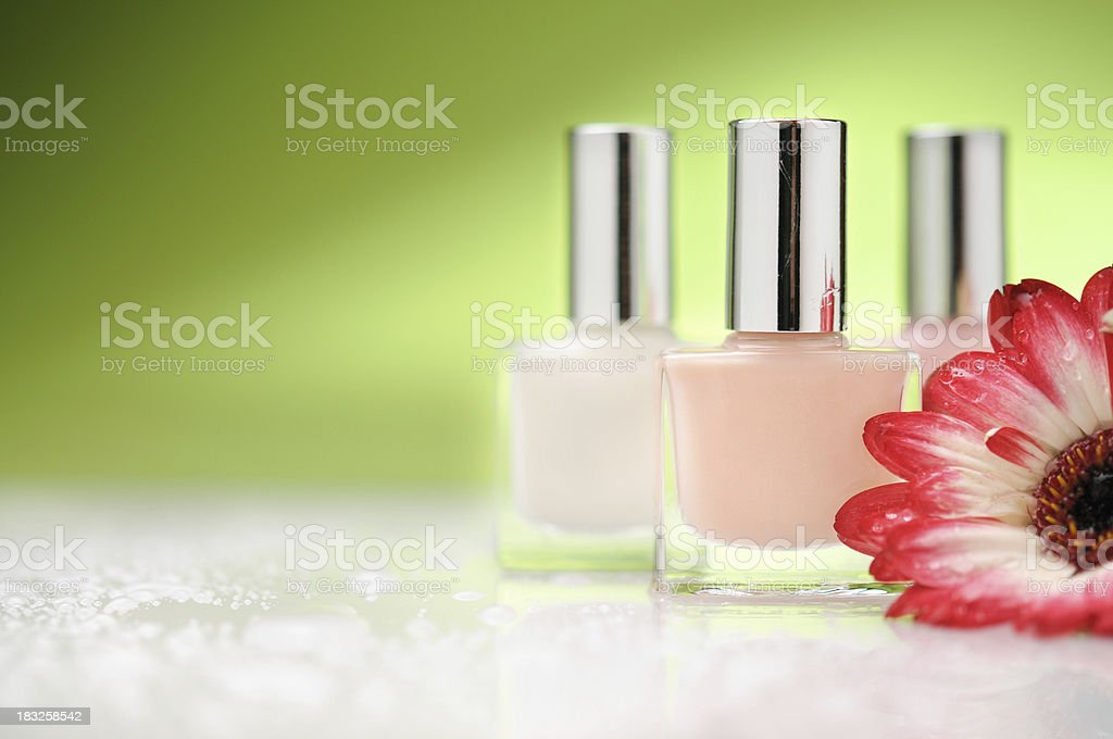 Nail polish bottles with a flower royalty-free stock photo