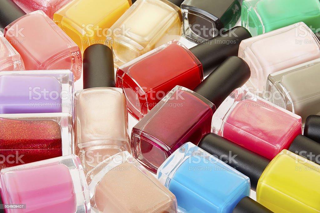 Nail polish colorful bottles background stock photo