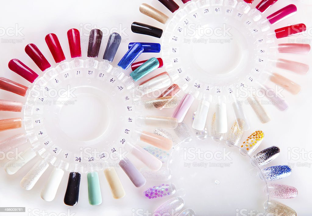 Nail polish, manicure, gel color sample disks. stock photo