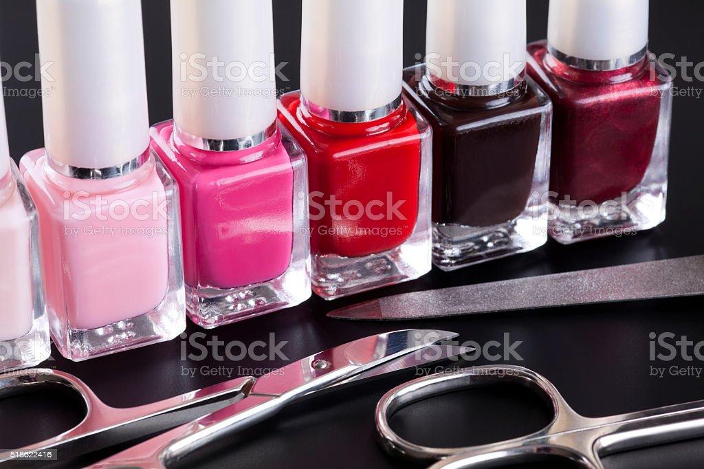 Nail polishes and manicure set stock photo