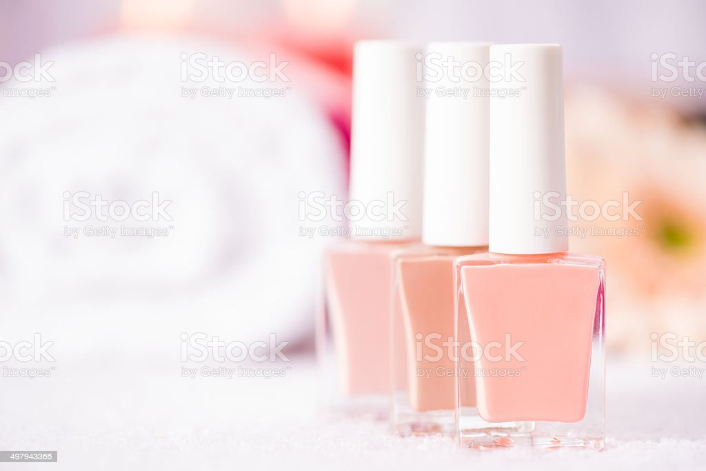 Nail polishes standing on the table stock photo