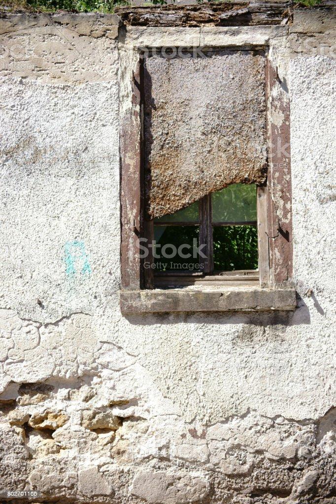 Nailed Ruin window stock photo