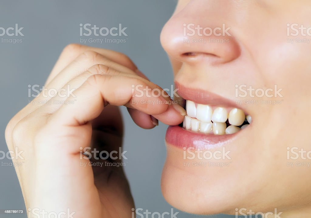 nails biting stock photo