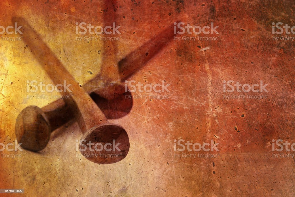 Nails from the Crucifixion against a Grunge Background stock photo