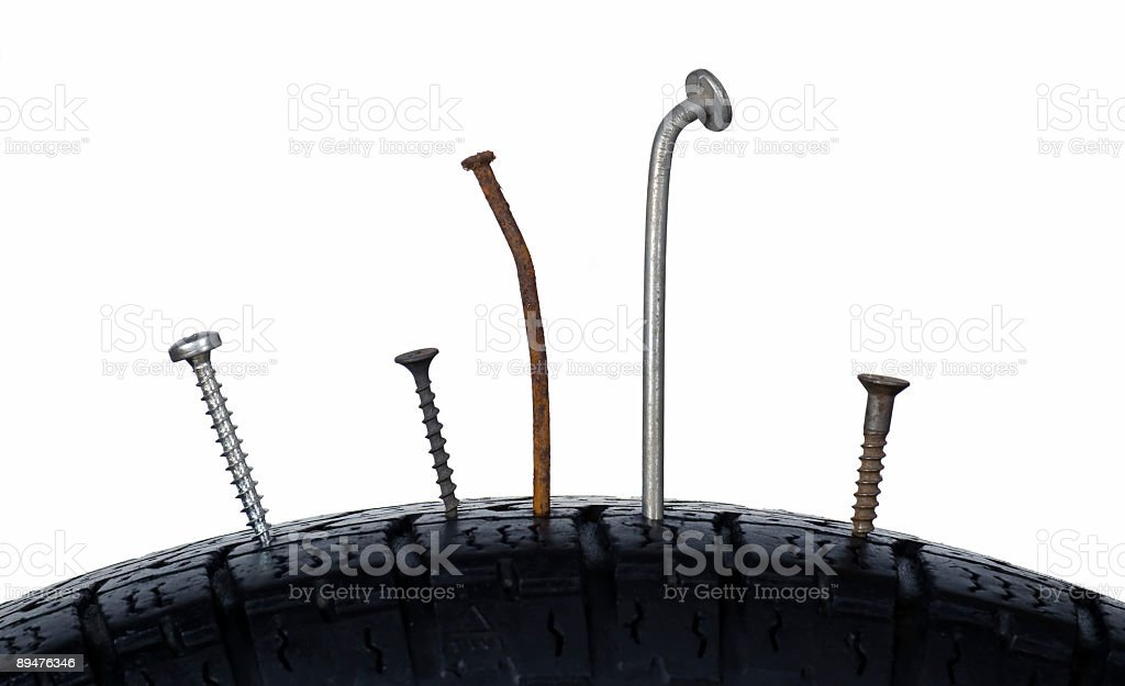 Nails in wheel royalty-free stock photo