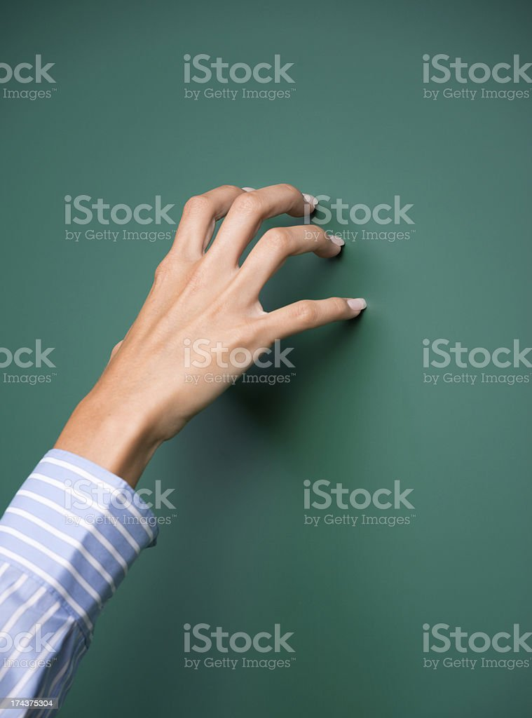 Nails scratching over Chalkboard / Blackboard stock photo