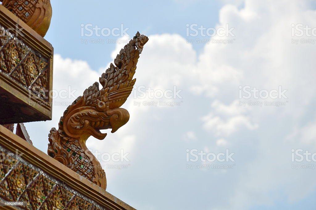 Naka king of snake statue on temple roof stock photo