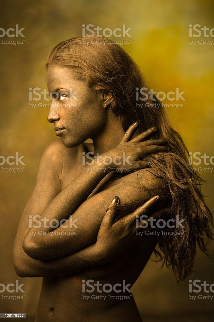 Naked Body Painted Young Woman with Long Hair Posing royalty-free stock photo