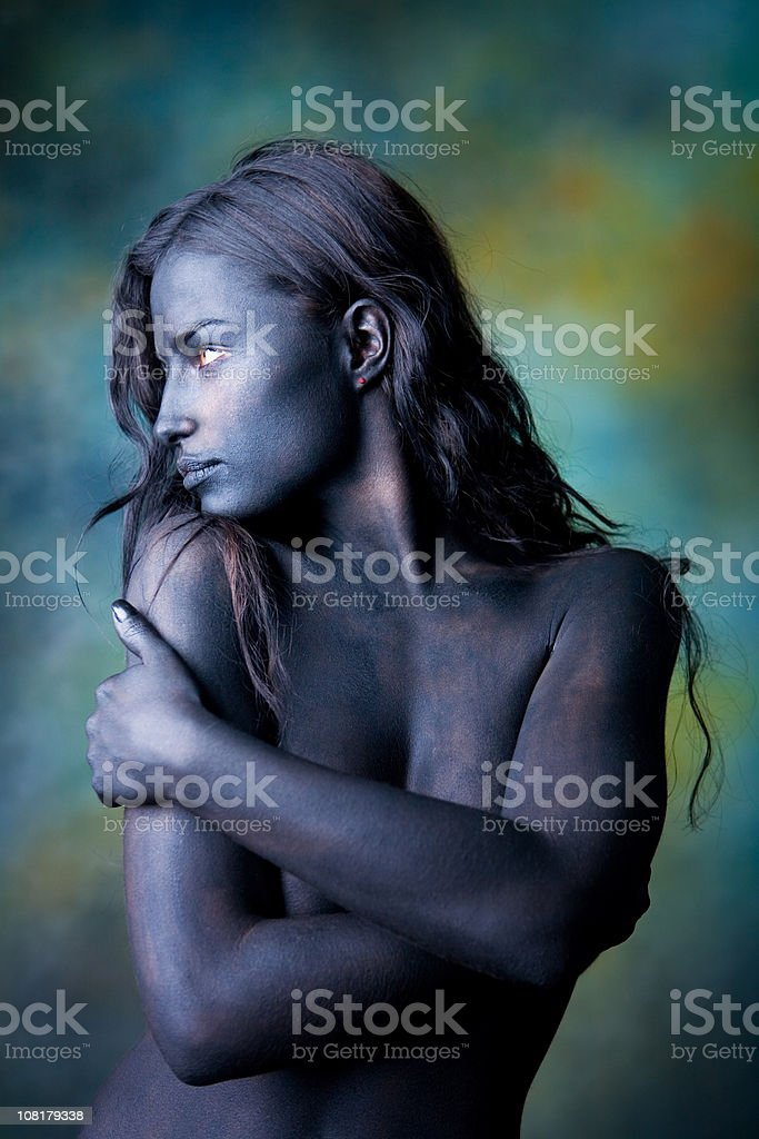 Naked Body Painted Young Woman Wrapping Arms Around Herself royalty-free stock photo