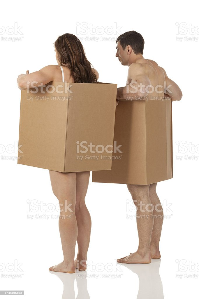 Naked couple under cardboard boxes royalty-free stock photo