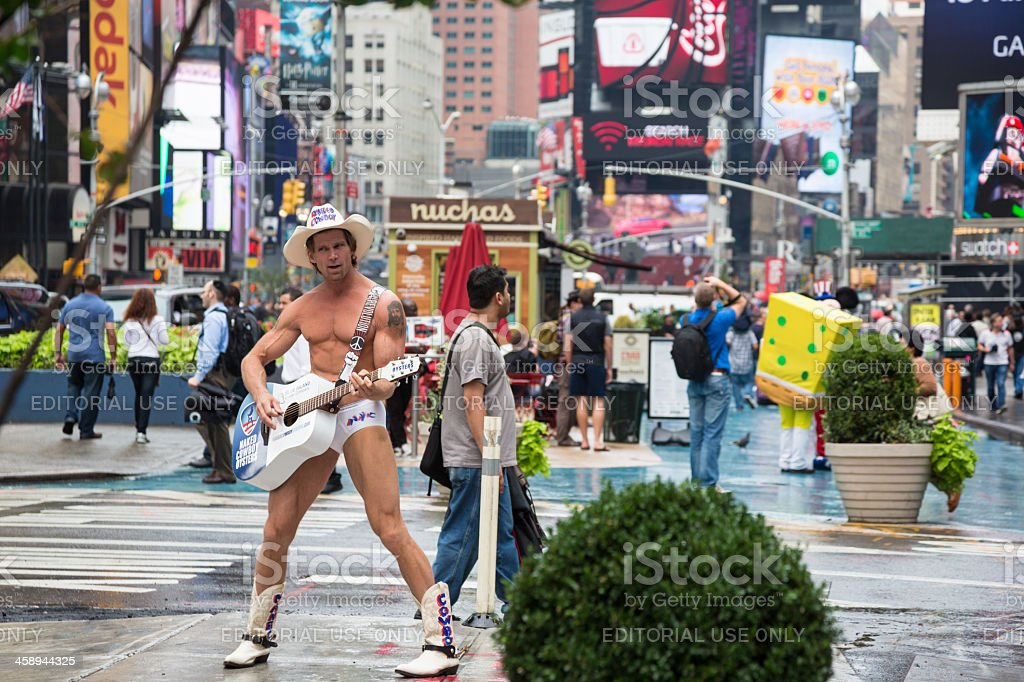 Naked Cowboy playing guitar on Times Square, New York City royalty-free stock photo
